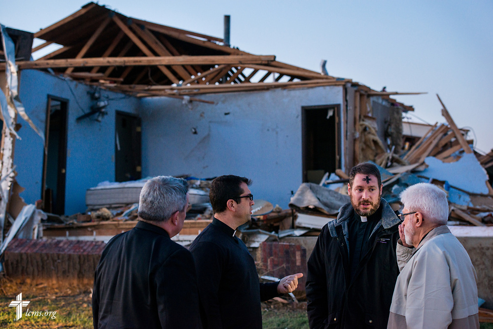 The Rev. Thomas Handrick, Sr., pastor of Immanuel Lutheran Church (right), talks to the Rev. Michael Meyer, manager of LCMS Disaster Response, the Rev. Ross Johnson, director of LCMS Disaster Response, and the Rev. Lee Hagan, LCMS Missouri District president (left), outside a church member's destroyed home on Wednesday, March 1, 2017, in Perryville, Mo. The night before, violent tornadoes ripped through parts of the town. LCMS Communications/Erik M. Lunsford