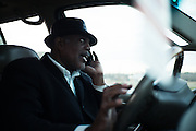 "MONTGOMERY, AL – JANUARY 25, 2016: Michael Harris, 52, receives a call from a client while driving to the Greyhound bus station. In 2011, the downtown Montgomery Greyhound bus station was converted into a museum to honor the freedom riders, who endured a violent attack there in 1961. The replacement bus station, located four miles from downtown, is a prime business opportunity for independent cabbies like Michael Harris, who make a living serving passengers unwilling to rely on city buses. Many characterize the public bus system in Montgomery as unsafe and unreliable, so wary passengers cough up $2 per mile for trips in Mr. Harris' 2005 Lincoln Navigator, traveling across town for fast food, or sometimes as far as New York City. ""This is my life,"" Harris said. ""I love driving, and I help people out. It's just in my heart."""
