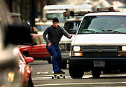 Justin Hindery cuts around a van who neglected to see him as he commutes to work along Fourth Avenue. A longtime skateboarder, he is seldom disturbed with the improper acts of drivers on the road. The trick is to always be looking ahead for the next trouble spot.