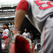 NEW YORK, NEW YORK - July 10: Catcher Sandy Leon, (center), #3 of the Boston Red Sox prepares to head out to catch as Mookie Betts #50 of the Boston Red Sox cleans his shoes before heading out to the outfield during the Boston Red Sox Vs New York Yankees regular season MLB game at Yankee Stadium on July 10, 2016 in New York City. (Photo by Tim Clayton/Corbis via Getty Images)