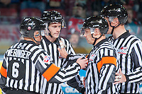 KELOWNA, CANADA - DECEMBER 4: WHL officials stand at center ice at the start of the game between Kelowna Rockets and Medicine Hat Tigers on December 4, 2015 at Prospera Place in Kelowna, British Columbia, Canada.  (Photo by Marissa Baecker/Shoot the Breeze)  *** Local Caption *** officials; referees; linesman;