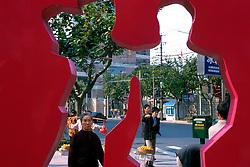 CHINA SHANGHAI NOV01 - Downtown street scene seen through sculpture.. . jre/Photo by Jiri Rezac. . © Jiri Rezac 2001. . Contact: +44 (0) 7050 110 417. Mobile:  +44 (0) 7801 337 683. Office:  +44 (0) 20 8968 9635. . Email:   jiri@jirirezac.com. Web:     www.jirirezac.com