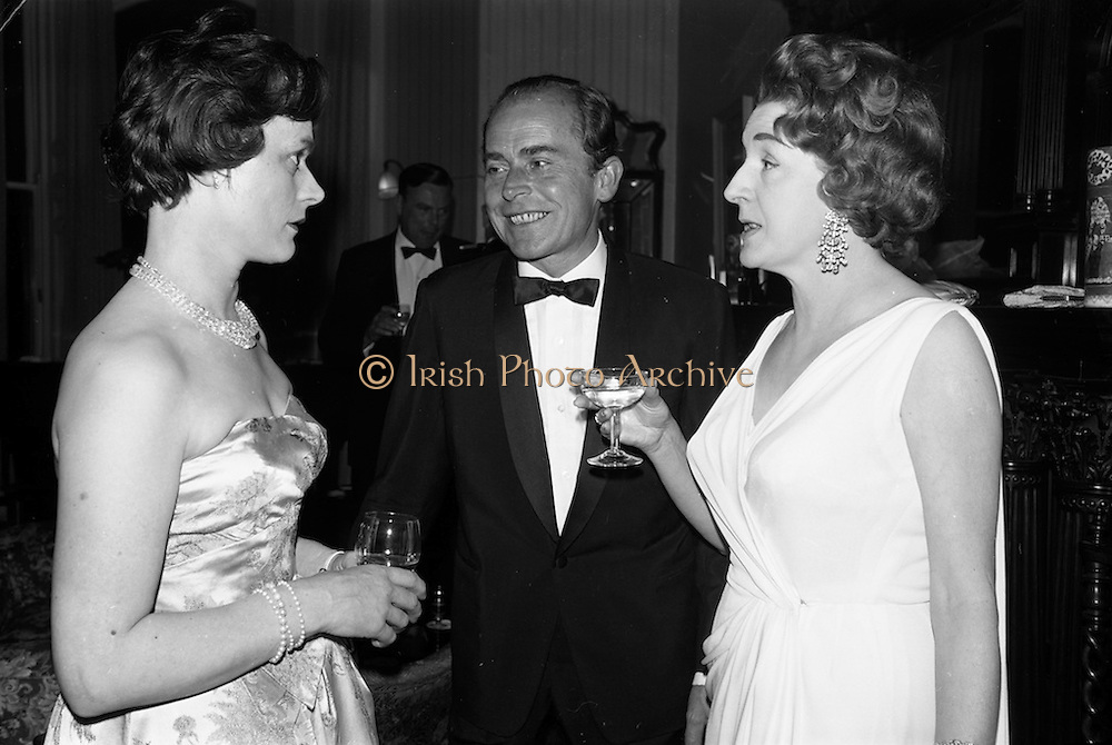 08/05/1964<br /> 05/08/1964<br /> 08 May 1964<br /> Reception and buffet dinner-dance for 5th Annual Tara Cup Rotterdam - Dublin Air Rally given by J.H. Van Anrooy at the Glencormac House Hotel, Co. Wicklow. At the event were (l-r): Mrs Tommy Hamilton of Kilbride and Mr and Mrs M. Slingsby.
