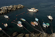 Manarola, Italy 101211  Fishing boats ducked at Manarola, which is part of the  the Parco Nazionale delle Cinque Terre.  (Essdras M Suarez/ EMS Photography)