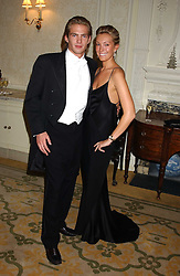 MR JACOBI ANSTRUTHER-GOUGH-CALTHORPE and MISS OLIVIA BUCKINGHAM at a dinner hosed by Moet & Chandon at their headquarters at 13 Grosvenor Crescent, London on 12th October 2005.<br />