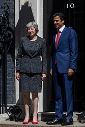 © Licensed to London News Pictures. 24/07/2018. London, UK. Prime Minister Theresa May greets Emir of Qatar Tamim bin Hamad Al Thani outside 10 Downing Street. Photo credit: Rob Pinney/LNP