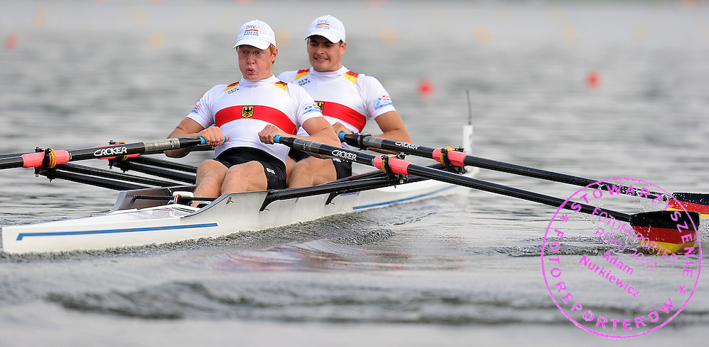 (L) STEPHAN KRUEGER & (R) ERIC KNITTEL (GERMANY) COMPETE IN THE SEMIFINAL MEN'S DOUBLE SCULLS DURING DAY FIVE OF REGATTA WORLD ROWING CHAMPIONSHIPS ON MALTA LAKE IN POZNAN, POLAND...POZNAN , POLAND , AUGUST 27, 2009..( PHOTO BY ADAM NURKIEWICZ / MEDIASPORT )..PICTURE ALSO AVAIBLE IN RAW OR TIFF FORMAT ON SPECIAL REQUEST.