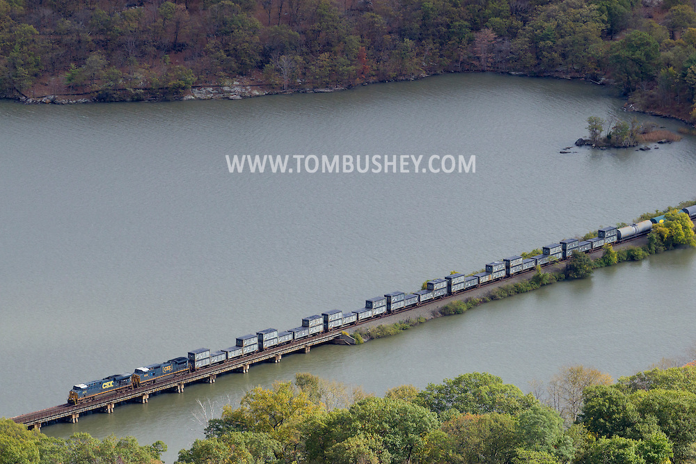 Bear Mountain, New York - A freight train heads north on the railroad track on the western side of the Hudson River in a view from the top of Bear Mountain at Bear Mountain State Park on Oct. 24, 2014.