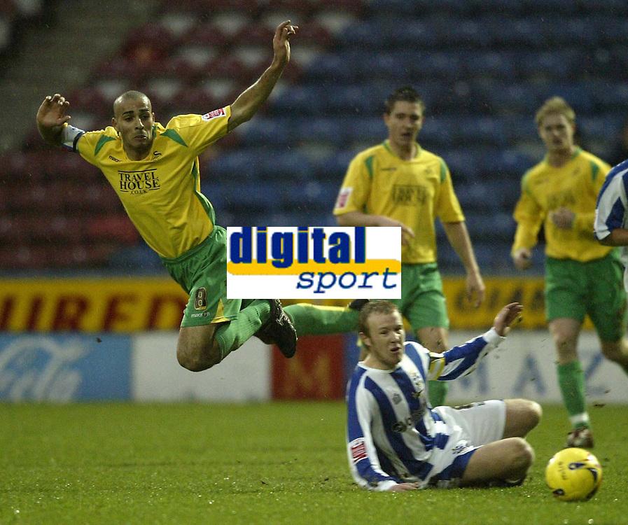 Photo: Aidan Ellis.<br /> Huddersfield Town v Swansea City. Coca Cola League 1. 30/12/2006.<br /> Swansea's Darren Pratley leaps out of the way from a challenge from Huddersfield's Jon Worthington