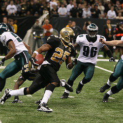 13 January 2007: New Orleans Saints running back Reggie Bush (25) runs away from Philadelphia Eagles defenders during a 27-24 win by the New Orleans Saints over the Philadelphia Eagles in the NFC Divisional round playoff game at the Louisiana Superdome in New Orleans, LA. The win advanced the New Orleans Saints to the NFC Championship game for the first time in the franchise's history.