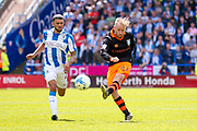 Sheffield Wednesday midfielder Barry Bannan (41) with a shot during the EFL Sky Bet Championship play off first leg match between Huddersfield Town and Sheffield Wednesday at the John Smiths Stadium, Huddersfield, England on 14 May 2017. Photo by Simon Davies.