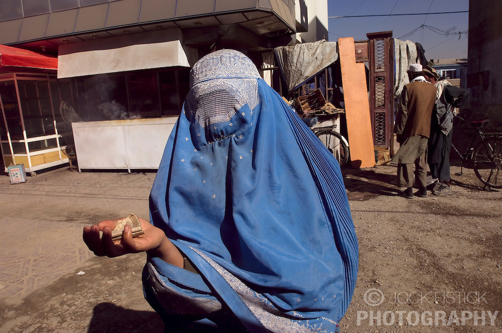 A Woman begs in the streets of Kabul, Afghanistan. (Photo © Jock Fistick)