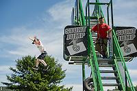 Kingsbury Hickok of Madbury, NH does his best Stunt Jump off the platform at Gunstock Mountain Resort.   (Karen Bobotas/for the Laconia Daily Sun)