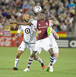 March 18, 2017 - Commerce City, Colorado, U.S - Rapids DOMINIQUE BADJI, center, gets tackled from behind by Minnesota's JEROME THEISSON, right, and COLLEN WARNER, left, during the 1st. Half at Dicks Sporting Goods Park Sat. night. The Rapids draw 2-2 to Minnesota United FC. (Credit Image: © Hector Acevedo via ZUMA Wire)