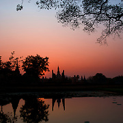 Wat Mahathat at sunset in Sukhothai. The Sukhothai kingdom was an early Thai kingdom in north central Thailand. It existed from during the 13th to 15th centuries The.old capital is in ruins and is a Historical Park..