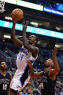 Mar 17, 2017; Phoenix, AZ, USA; Orlando Magic forward Jeff Green (34) goes up with the basketball against Phoenix Suns guard Ronnie Price (14) in the first half of the NBA game at Talking Stick Resort Arena. Mandatory Credit: Jennifer Stewart-USA TODAY Sports
