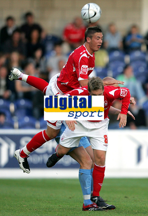 Photo: Paul Thomas.<br /> Chester City v Nottingham Forest. The Carling Cup. 14/08/2007.<br /> <br /> Luke Chambers (Top) of Forest wins the ball ahead of his own team-mates Kris Commons (8) and Kevin Ellison (Background).