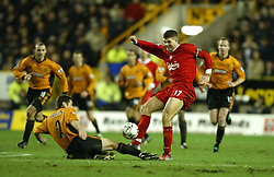 WOLVERHAMPTON, ENGLAND - Wednesday, January 21st, 2004: Liverpool's Steven Gerrard is tackled by Wolverhampton Wanderers' Denis Irwin during the Premiership match at Molineux. (Pic by David Rawcliffe/Propaganda)