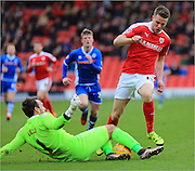 Sam Winnall, Josh Lillis during the Sky Bet League 1 match between Barnsley and Rochdale at Oakwell, Barnsley, England on 23 January 2016. Photo by Daniel Youngs.