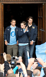 © licensed to London News Pictures. Manchester, UK  23/05/2011. Left and centre: Alexanda Kolorov, Adam Johnson. Tens of thousands of fans line the streets of Manchester as Manchester City Football Club hold an open-topped bus parade through the city. The team are celebrating winning the FA Cup, their first trophy in 35 years, and for qualifying for next season's Champions League. Please see special instructions for usage rates. Photo credit should read Joel Goodman/LNP