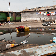 A pool of stagnant water in Agbogbloshie, a slum in Ghana's capital, Accra. Poor drainage creates breeding places for mosquitoes, spreading malaria.