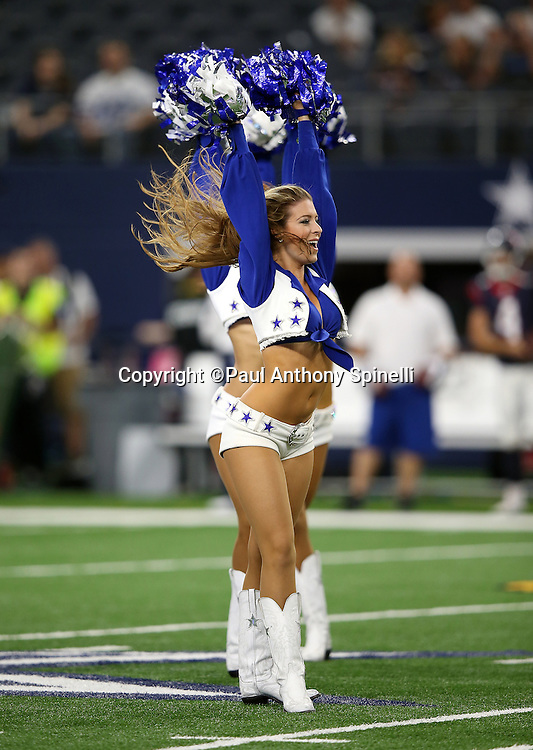 The Dallas Cowboys cheerleaders perform during the Dallas Cowboys 2015 NFL preseason football game against the Houston Texans on Thursday, Sept. 3, 2015 in Arlington, Texas. The Cowboys won the game 21-14. (©Paul Anthony Spinelli)