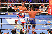 Tony Bellew and David Haye both raise arms at each other at the O2 Arena, London, United Kingdom on 5 May 2018. Picture by Phil Duncan.