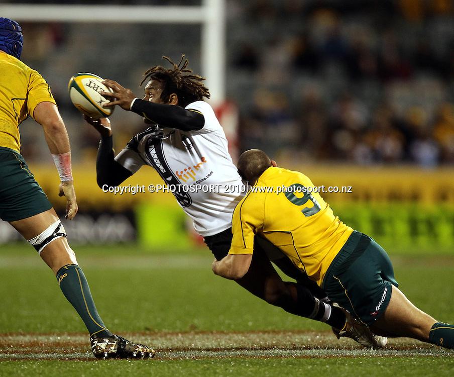 Waisea Luveniyali tackled by Luke Burgess<br /> International Test rugby union match, Australia v Fiji, Canberra, Australia. Saturday 5 June 2010. Photo: Paul Seiser/PHOTOSPORT