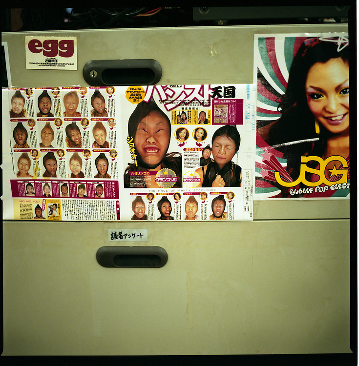 "Page from Egg Magazine, a magazine for the ""ko-gal"" and ""gal-O"" market, posted on filing cabinet in editorial office, Shibuya, Tokyo, Japan."