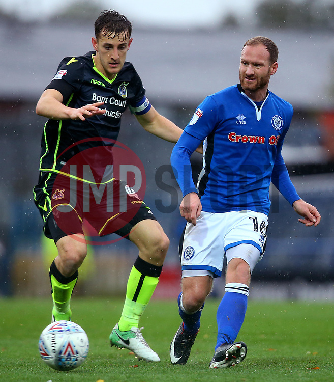 Matt Done of Rochdale passes the ball under pressure from Tom Lockyer of Bristol Rovers - Mandatory by-line: Robbie Stephenson/JMP - 21/10/2017 - FOOTBALL - Crown Oil Arena - Rochdale, England - Rochdale v Bristol Rovers - Sky Bet League One