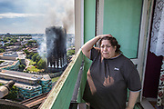 File picture.<br /> Former Grenfell Tower resident Georgina Agguire stands distraught on her balcony as Grenfell Tower, a 24-storey social housing block, burns behind her in the Royal Borough of Kensington and Chelsea, West London, England on the 14th of June 2017. The fire, which originally started from a faulty fridge-freezer appliance on the fourth floor, resulted in the deaths of 72 people, leading the UK Government to carry out a nationwide independent review into building regulations and fire safety.<br /> Georgina had moved to Whitstable House, the building next door four years prior to the fire.
