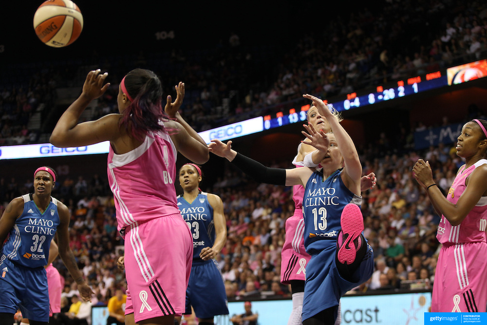 Lindsay Whalen, (centre), Minnesota Lynx, is challenged by Katie Douglas, Connecticut Sun, during the Connecticut Sun Vs Minnesota Lynx, WNBA regular season game at Mohegan Sun Arena, Uncasville, Connecticut, USA. 27th July 2014. Photo Tim Clayton