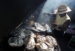 Jim Yancey tends to the grill at Smokin' Jim's Bar-B-Q at 111 East Main St. in Gloucester. Jim's offers a variety of barbecue meats and side dishes for take-out.
