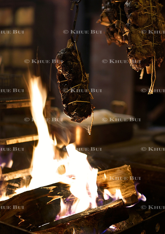 Lamb shoulder cooking over the fire at Maydan Friday, January 26, 2018, in Washington, DC.<br /> <br /> Photo by Khue Bui