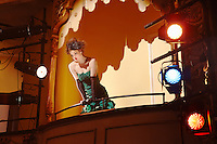 Young woman in theatre box