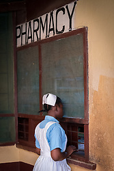 2 November 2019, Ganta, Liberia: A nurse waits for medicine at the pharmacy of Ganta Hospital. Located in Nimba county, the Ganta United Methodist Hospital serves tens of thousands of patients each year. It is a founding member of the Christian Health Association of Liberia.