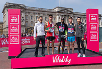 Justin Tourog, Vitality Managing Director and Jessica Ennis Hill flank Matthew Sharpe (bronze), Mo Farah (gold) and Richard Allen (silver) winners of the Elite Men's Race on the podium outside Buckingham Palace. The Vitality London 10,000, Monday 30th May 2018.<br /> <br /> Photo: Bob Martin for The Vitality London 10,000<br /> <br /> For further information: media@londonmarathonevents.co.uk