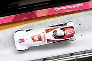 South Korea, PyeongChang - 2018 February 18: (R) Pilot Mateusz Luty and (L) Krzysztof Tylkowski both from Poland compete while 2-man Men's Bobsleigh Official Training Heats 5 during The 2018 PyeongChang Olympic Winter Games at Olympic Sliding Centre on February 18, 2018 in PyeongChang, South Korea.<br /> <br /> Mandatory credit:<br /> Photo by &copy; Adam Nurkiewicz<br /> <br /> Adam Nurkiewicz declares that he has no rights to the image of people at the photographs of his authorship.<br /> <br /> Picture also available in RAW (NEF) or TIFF format on special request.<br /> <br /> Any editorial, commercial or promotional use requires written permission from the author of image.