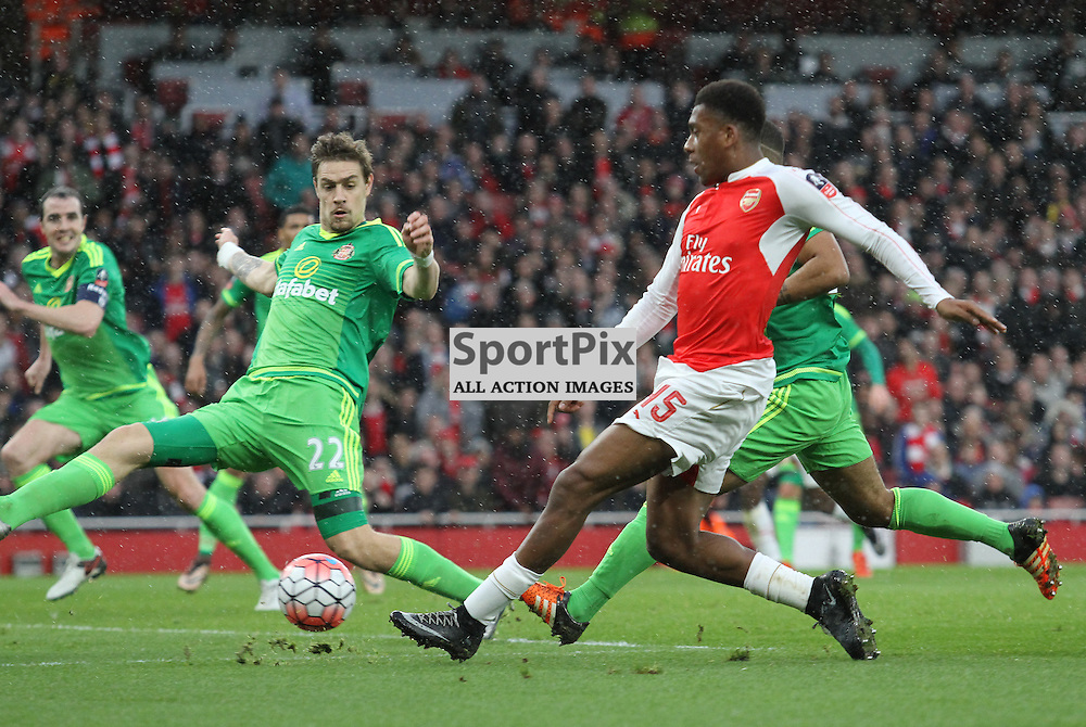 Iwobi fires a shot on the Sunderland goal but is denied by Sebastian Coates
