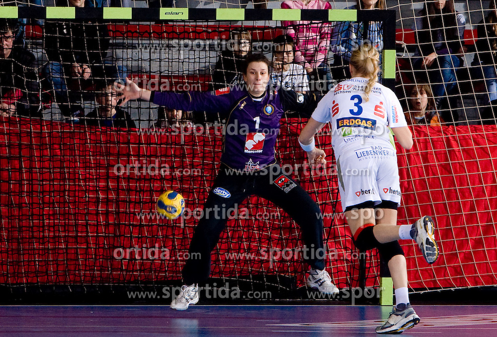 Goalkeeper of Krim Jelena Grubisic  vs Mette Ommundsen of Leipzig during 2nd Round of Group 1 at Women Champions League handball match between RK Krim Mercator, Ljubljana and HC Leipzig, Germany on February 13, 2010 in Arena Kodeljevo, Ljubljana, Slovenia. Krim defeated  Leipzig 32-26. (Photo by Vid Ponikvar / Sportida)
