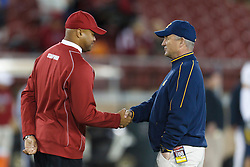 Nov 19, 2011; Stanford CA, USA;  Stanford Cardinal head coach David Shaw (left) shakes hands with California Golden Bears head coach Jeff Tedford (right) before the game at Stanford Stadium.  Mandatory Credit: Jason O. Watson-US PRESSWIRE