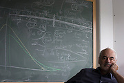 Portrait of mathematician and Risk guru, Professor Sir David Spiegelhalter with blackboard workings of probability, at the Centre for Mathematical Sciences at the University of Cambridge.