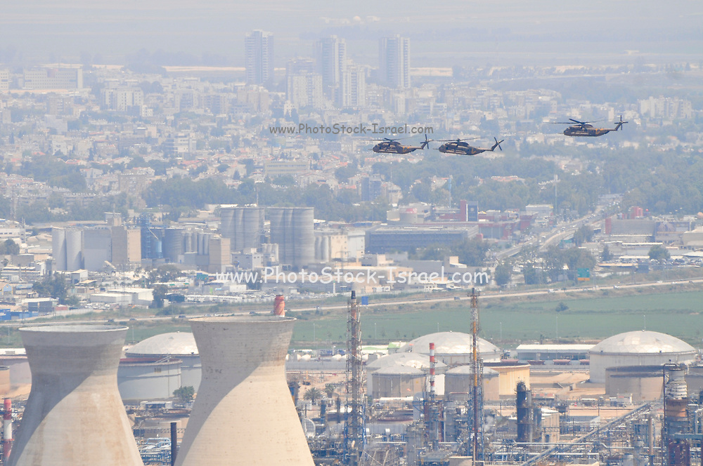 A formation of three Israeli Air force Sikorsky CH-53 helicopters in flight over Haifa Bay industrial zone