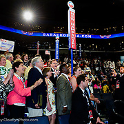 Video cameras capture the moment as NHDP Chair Raymond Buckley. surrounded by the delegation, casts all of NH's votes for Barak Obama at the2012 Democratic Convention.