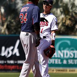 March 11, 2011; Fort Myers, FL, USA; Boston Red Sox first baseman David Ortiz (34) and Minnesota Twins second baseman Tsuyoshi Nishioka (1) talk during a spring training exhibition game at Hammond Stadium.   Mandatory Credit: Derick E. Hingle