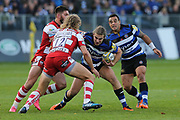 Bath centre Max Clarke (12) takes a tackle holding the ball during the Aviva Premiership match between Bath Rugby and Gloucester Rugby at the Recreation Ground, Bath, United Kingdom on 29 October 2017. Photo by Gary Learmonth.