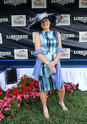 Guests participate in the Longines Most Elegant Woman at the Preakness contest, Saturday, May 17, 2014, in Baltimore, MD. Longines, the Swiss watch manufacturer known for its luxury timepieces, is the Official Watch and Timekeeper of the 139th annual Preakness Stakes and Triple Crown.  (Diane Bondareff/Invision for Longines)