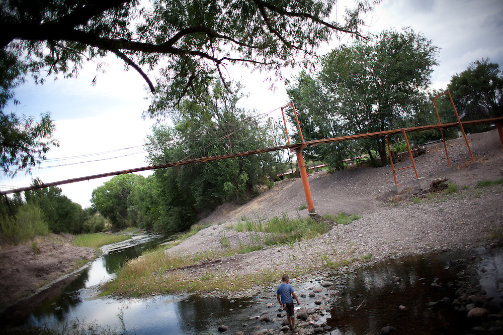 A young boy is seen walking near a mormon engineered suspension bridge that was rebuilt in the early 1900s after being washed away by a flood in Colonia Juarez, Mexico. United States Presidential candidate Mitt Romney's family migrated to Mexico over 100 years ago after being granted asylum from Mexican President Porfirio Diaz after they had been pursued by the U.S. authorities for polygamy. ..(Romney is currently running for the Republican nomination.)