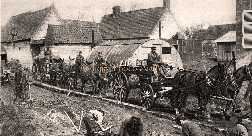 Canadian road, makers at work on a cordwood track for supply traffic, on the Western front.
