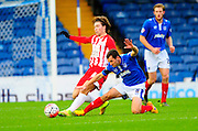 Accrington Stanley's Josh Windass and Portsmouth's Michael Doyle during the The FA Cup match between Portsmouth and Accrington Stanley at Fratton Park, Portsmouth, England on 5 December 2015. Photo by Graham Hunt.